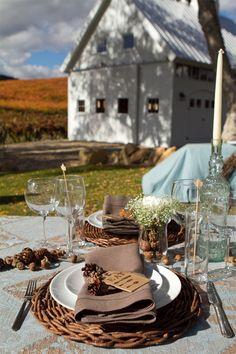 a nice Fall outdoor table setting...  the acorns and pine cones are festive ...but unshelled nuts would also be a nice rustic touch