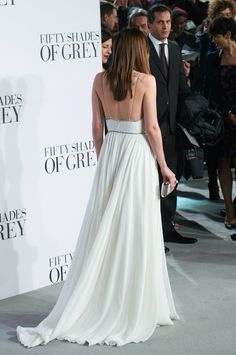 Dakota Johnson in a beautiful, backless Saint Laurent gown. London Premiere, Fifty Shades of Grey, February 2015. Very feminine and romantic.