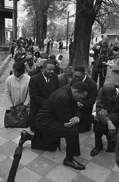 Rev. Martin Luther King, kneeling in peaceful protest for Civil Rights, in the 1960s. The battle continues today.