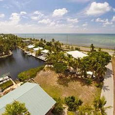 Sandy Cove Dr, Islamorada, FL Ready to build your dream home in Islamorada?! This home will have ocean views and great boating access. A TRE is included and the dock permit has been extended for 2 years. Located on a wide waterway with a dock permit for an L shaped dock and a boat ramp.