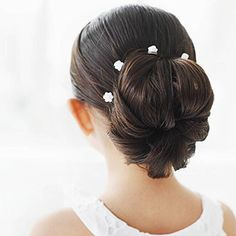 The Ballerina Chignon, a cute hair style I am going to attempt with my girls when they get a little older!