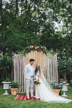 Boho garden wedding bride groom country alter dress veil lace rug salvaged door macrame curtains train