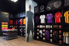 Retail Store by Unfold Creative Studio - Fan Wear Area organized by team to make it easier for fans Boutique Interior, Shop Interior Design, Visual Merchandising, Exhibition Booth Design, Exhibition Stands, Exhibit Design, Clothing Store Design, Store Layout, Stand Design