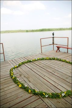 Wedding in a ring of flowers on a dock at Greer's Ferry Lake in Clinton, AR - Photo by Jason