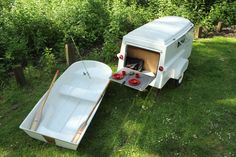 new american dream trailer with mattress, oars, oarlocks & wheel chocks; boat fits upside-down on top of trailer