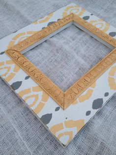 IKAT distressed picture frame 8x10 in yellow gray and cream. $58.00, via Etsy.