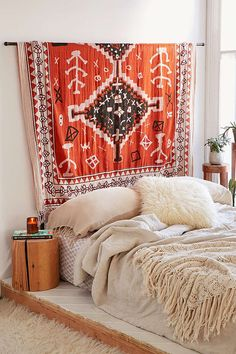 17 Ways To Make Your Home Look Like A Hippie Hideaway- hang a tapestry for a makeshift headboard
