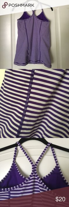 Nike Dri-Fit Striped Tank Dri-Fit workout tank! Has purple and white stripes throughout the top! Has a build in sports bra and is super comfortable! Worn maybe twice Nike Tops