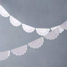 """Terrain is carrying our Doily garlands! Strung on white ribbon, this dainty garland is made from vintage-inspired, paper doilies cut in delicate patterns.- Paper, white ribbon- Indoor use only- USA2""""W, 120""""L"""