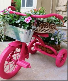 Add whimsy to garden-8 great idea for when the kids out grow there tricycle! tricycle plant holder