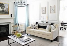 Elegant living room with a marble coffee table. cream sofa, and a Hermès Avalon Blanket