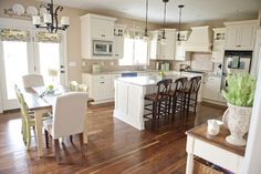 My dream kitchen! Soft tan walls, crisp white cabinetry, beautiful wood floors and bright light coming in. Kitchen Family Rooms, New Kitchen, Kitchen Decor, Kitchen Island, Kitchen Ideas, Country Kitchen, Crisp Kitchen, Island Table, Kitchen Time