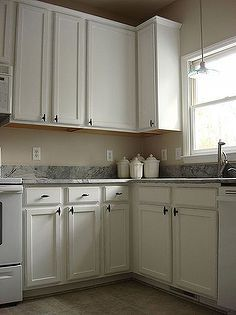 old oak cabinets painted white and distressed, cabinets, diy, kitchens,  painting,
