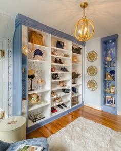 Part of the 2016 Richmond Symphony Orchestra League design showcase house. A Sporting Blue color match pairs well with white melamine slanted shoe shelves.