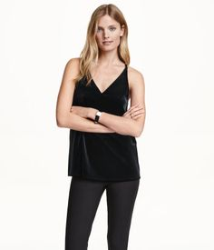 Flared V-neck camisole top in velvet with narrow shoulder straps and a racer back. Jersey lining in upper section.