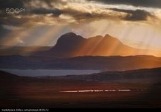 Sunbeams over Suilven par  Barbara Jones. Coigach. North West Scotland. - stock photo
