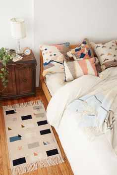 New rugs and pillow by Brooklyn textile artist Sara Berks aka MINNA