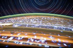 star trails and earth-light trails by NASA_JSC_Photo