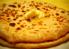 my all time favourite punjabi aloo parathas with extra butter/ghee! even more awesome when had with spicy mango pickle and cold raita (yoghurt with cut vegetables - cucumber, carrot, etc) How To Cook Garlic, Veg Restaurant, Punjabi Food, Paratha Recipes, Indian Food Recipes, Ethnic Recipes, Indian Foods, Cooking Recipes, Healthy Recipes