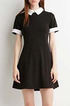 The dress made from cotton blend with colorblocked doll collar, short sleeve and zip back.