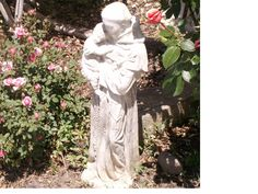 nice statue of St Anthony and the Child Jesus in a backyard garden