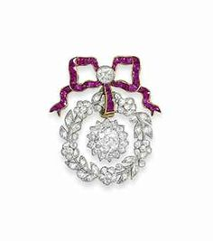 AN EDWARDIAN RUBY AND DIAMOND BROOCH The calibré French-cut ruby bow surmount with millegrain-set old-cut diamond centre, suspending a diamond-set wreath of flowerheads, buds and leaves, with central diamond cluster drop, mounted in platinum and gold, circa 1910, 4.3cm long