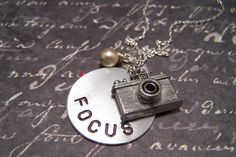 Hey, I found this really awesome Etsy listing at http://www.etsy.com/listing/92029909/camera-necklace-focus-photography
