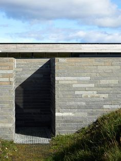 Cliff House by Dualchas Architects offers panoramic views of a Scottish loch.