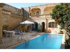 Gozo Holiday Rent:  #gozo #malta #holiday #accommodation #rent #let #apartments #villa #farmhouse  A very large traditional character FARMHOUSE set around a central Sun Deck with open plan first floor verandah and good basic furnishings, ideal for a large family holiday. Comprises: Entrance from Courtyard, Double doors to Open Plan Living/Dining Room/Kitchen, fitted with hob, oven and fridge-freezer, microwave oven, telephone, television and DVD.