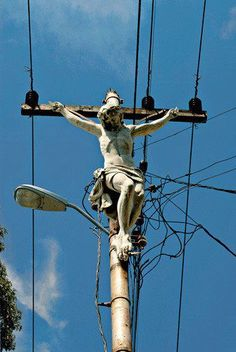 Jesus sculpture on utility poles.