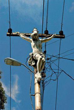 Jesus sculpture on utility poles.