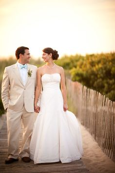 khaki suits would be pretty w/ green bridesmaid dresses:)