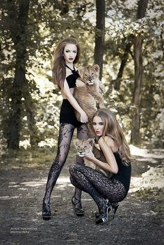 Hot models and cats. I want to do a shoot like this someday. Someone please give me a few lion cubs for a day?