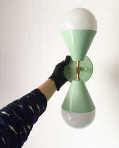 M I N T • CORDELIA DESCRIPTION: First photo in Mint green - all others in all brass This duel bulb sconce is perfect for hanging horizontally or