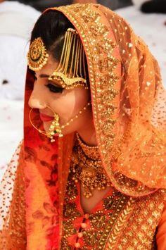Sikh Wedding Brides - Orange Anarkali with Gold Jewellery | WedMeGood Gold Jhoomer and Gold Maangtikka with A beautiful orange and gold dupatta #wedmegood #sikh #bride