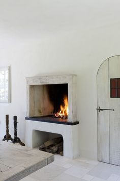 My dream home features a kitchen fireplace that looks like this. Build A Fireplace, Fireplace Design, Fireplace Kitchen, Open Fireplace, Fireplace Shelves, Concrete Fireplace, Home Design, Design Ideas, Minimalist Fireplace