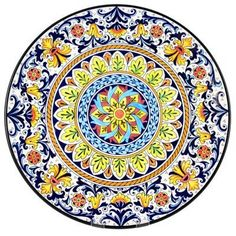 Hand Painted Sevilla 3 Ceramic Plate by Hot Paella. $80.00. Hand made ceramics from Spain. Size: 12.5 inch diameter. Lead-free. Authentic pieces brought to you direct from the remote villages in Spain.. Not dishwasher safe, please hand wash. - Lead Free - Food Safe - So beautiful you will be tempted to display it, but these plates are certainly durable enough to use for serving food.  Mounting hole cast into back rim so it may be hung on a wall.