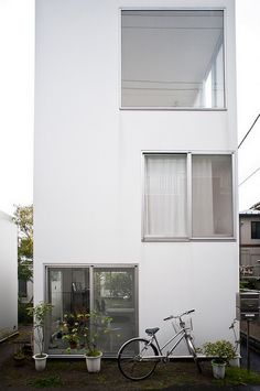 """The Moriyama House goes against the grain of high city life in Tokyo, Japan. Instead, it relates to the Japanese tradition of the minimalist apartment. Ryue Nishizawa, the break through architect of the """"Moriyama House"""" complex, has created these homes in such a way that allows residents to feel familiar surrounded by typical, crowded city life, but also experience quiet tranquility in a suburban setting through quaint gardens, open and large windows, and simplistic, white buildings."""