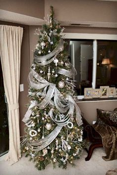 [ Christmas Tree Themes : Illustration Description 110 feet of ribbon on this elegant tree by SeasonalDecorating (from the Holiday Forum on Garden Elegant Christmas Trees, Peacock Christmas, Silver Christmas Decorations, Ribbon On Christmas Tree, Christmas Tree Themes, Noel Christmas, Pink Christmas, Rustic Christmas, Outdoor Christmas