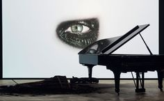 In Phantom (2011), Gordon, collaborating with singer/songwriter Rufus Wainwright, examines grief and longing in a sonic and visual requiem. Expanding upon his use of portraiture as a tool for investigating the human condition, Gordon employs slow-motion film produced with a high-speed Phantom camera. The film focuses on Wainright's eye—blackened with make-up, weeping, and glaring back at the viewer, echoing melodramatic performances by stars of the silent screen.