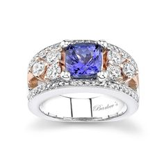 Rose Gold Tanzanite Ring - 6987LW - Tanzanite and diamond two tone ring, featuring a prong set cushion shape tanzanite set in a white gold shank accented with rose gold shared prong set diamonds gracing the open shoulders.  Pave set diamonds adorn the ridges for an elegant unique ring sure to captivate many admirers.  Also available in 18k, and Platinum.