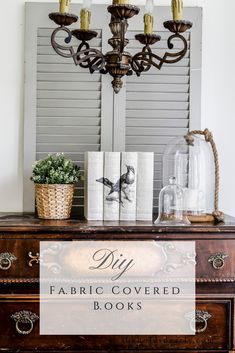 DIY Fabric Covered Books by sheholdsdearly.com #diylinenbookcovers #coverhardbackbooks #linenwrappedbooks #diyfabriccoveredbooks Farmhouse Spring Gift Ideas Farmhouse Decorating Details