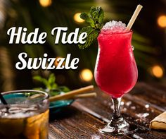 HIDE TIDE SWIZZLE. Captain Morgan Grapefruit Rum and Myers's Dark Rum, hibiscus, fresh lime and falernum. Shaken & topped with mint sprigs and sugarcane, served over crushed ice.