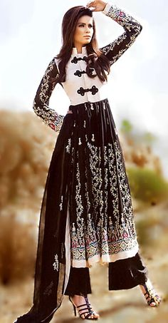 For the fashion forward, here's a combination of diverse styles - a jacket inspired neck, an anarkali cut for the rest of the kurta; paired with wide parallel pants. All in a striking black and white combination. #indian