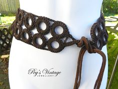 Fabulous Crochet-covered plastic rings made into a belt . Retro style 1980s fashion accessory  Rich brown color thread wide ring design belt