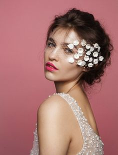 Ditch the veil and make your grand entrance in this romantic and flirty bandeau mask.