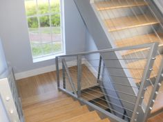 Interior staircase railing: Welded Post and Rail with Stainless Cable Infill from http://stainlesscablerailing.com
