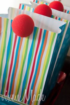 Favor bags- great idea to put clown noses on the bags!