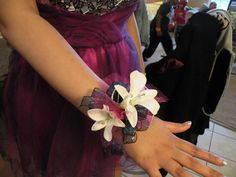 Silk Wrist Corsage Done With White Orchids With Rhinestone Accents & Hot Pink & Black Trimmings