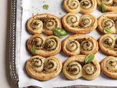 Pesto Pastries | Impress your guests with these sophisticated five-ingredient-or-less appetizers. They're elegant, easy, and, because they have so few ingredients, won't break your budget. These recipes range from great dips, fantastic cocktail shrimp platters, or even elegant party crackers. Serve up a great dish of goodies to your guests while making it easy on your budget.